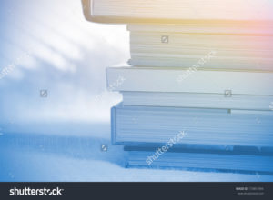 stock-photo-deck-of-books-with-soft-light-173851994