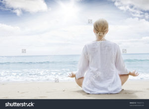 stock-photo-portrait-of-young-woman-practicing-yoga-in-summer-environment-74925715