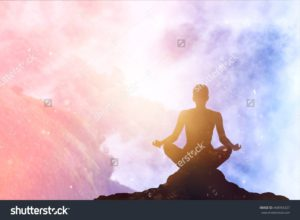 stock-photo-woman-meditating-colorful-pastel-on-high-mountain-in-sunset-background-468956327