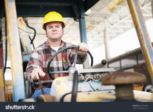 stock-photo-worker-driving-heavy-construction-equipment-bulldozer-or-backhoe-207259786
