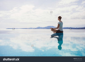 stock-photo-young-woman-meditating-outdoors-360419555